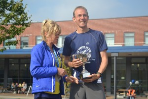 The winner of the 2015 Rainford 10K being presented with the George Faulkner Memorial Trophy.
